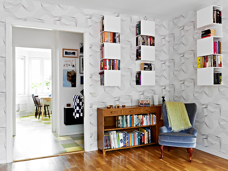 http://nordicbliss.files.wordpress.com/2011/08/scandinavian-style-wall-paper-book-cases-wood.jpg